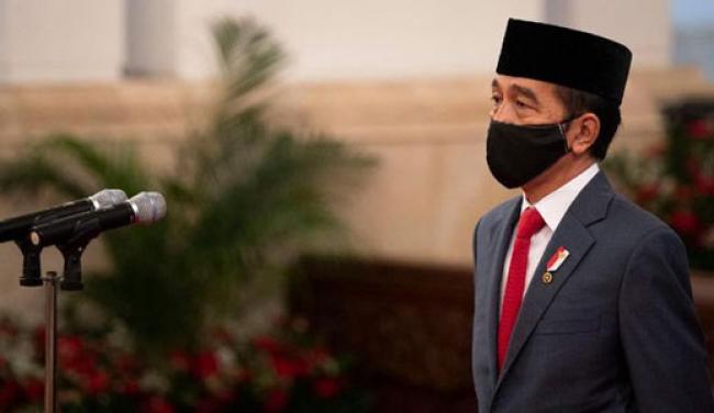 Jokowi Teken Perppu Penundaan Pilkada 2020